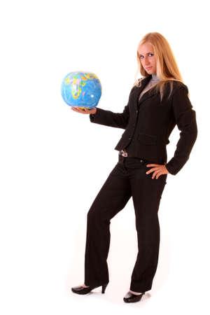Happy girl with globe on white photo