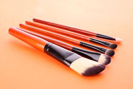 cosmetic brushes on  orange background photo