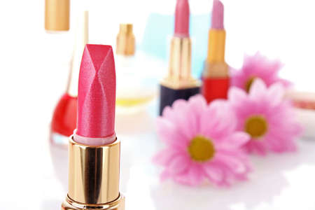 New lipstick on cosmetics and flower  background photo