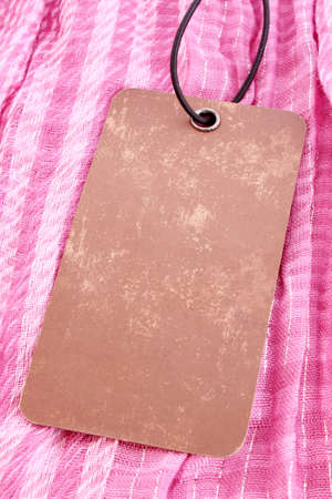 Label on pink textile background photo