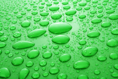 Green water drops background Stock Photo - 6572061