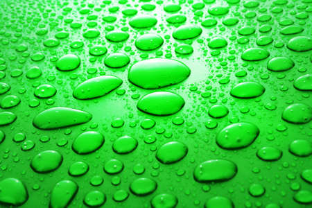 Green water drops background Stock Photo - 6605899