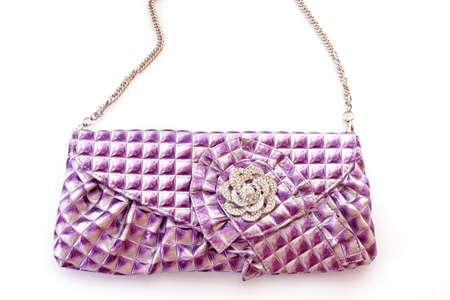 Violet purse on white background photo