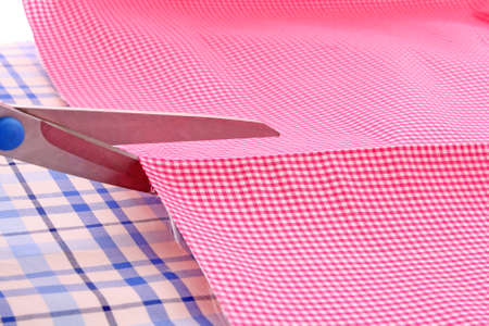 Dressmaker cuts scissors fabrics Stock Photo - 6645450