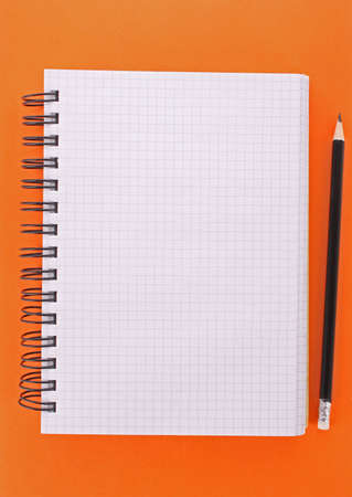 Notebook with pencil on the yellow background Stock Photo - 6645514
