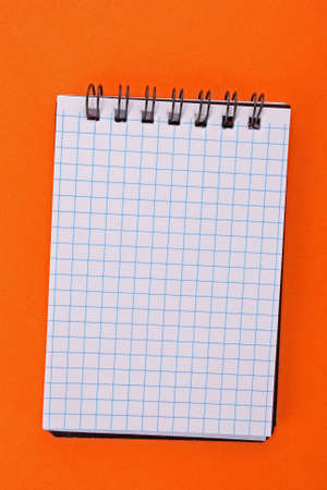 Notebook on the orange background Stock Photo - 6645531