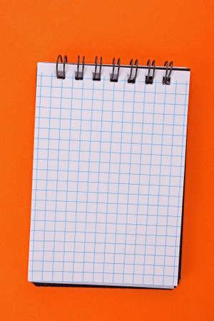 Notebook on the orange background Stock Photo - 6645531