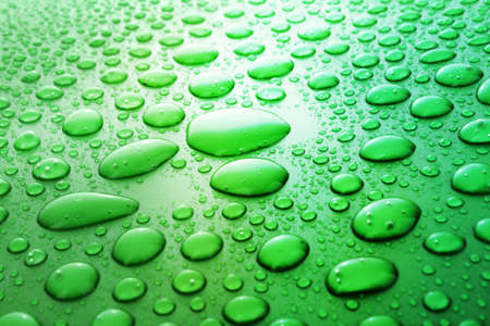 water drops background with big and small drops photo