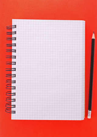 Notebook with pencil on the yellow background Stock Photo - 6801664