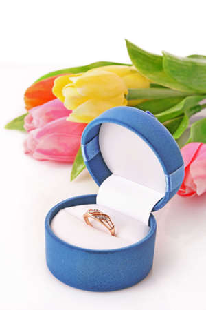 Gold  engagement ring in box on the flowers background Stock Photo - 6801767