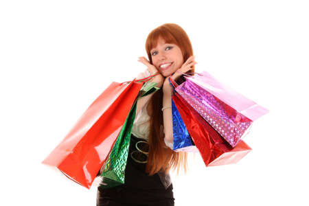 boxing day sale: Beautiful, young, redhead woman with color shopping bags in her hand. Isolated on white background.