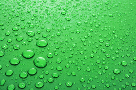 Green water drops background with big and small drops photo