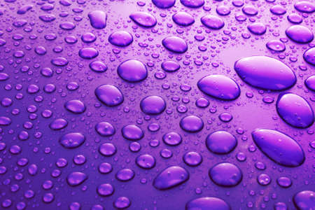 Violet water drops background with big and small drops Stock Photo - 6882579