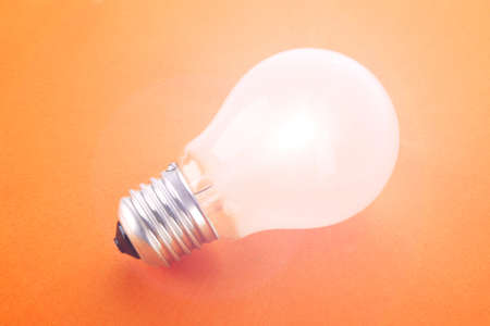 incandescence: Light bulb on yellow background