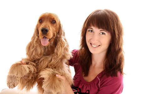 Young brown cocker spaniel and young woman on white background photo