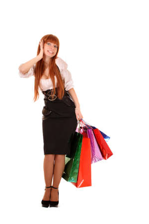 boxing day sale: Beautiful, young, redhair woman with color  shopping bags in her hand.  Isolated on white background.