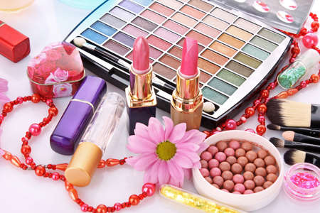 Many colourful woman cosmetics with flower   on white white background photo