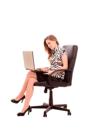 businesswoman in chair with laptop on white background photo