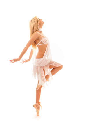young and beautiful ballerina in white dress over white background Stock Photo - 7078606