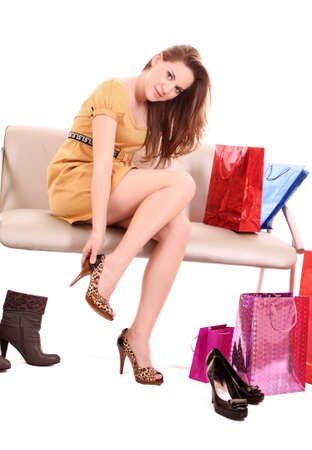 Fashion portrait of a beautiful young woman in leopard shoes photo
