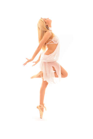 pointe: young and beautiful ballerina in white dress over white background Stock Photo