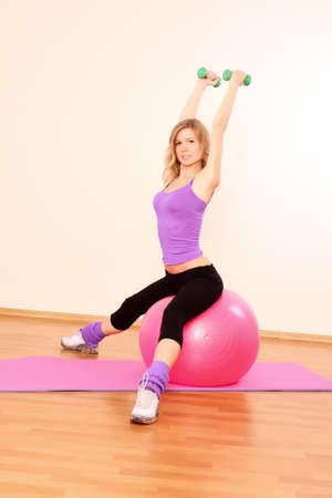 Young beautiful fitness girl exercising  in the gym Stock Photo - 7141986