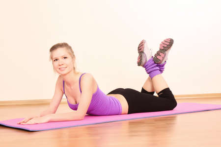 Young beautiful fitness girl exercising  in the gym Stock Photo - 7141960