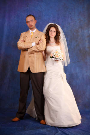 Bride and groom over blue studio background Stock Photo - 7185865
