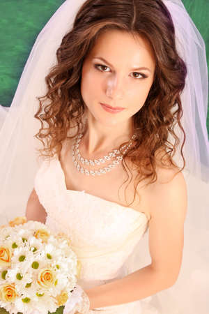 Beautiful woman with in  wedding dress over blue studio background Stock Photo - 7185894
