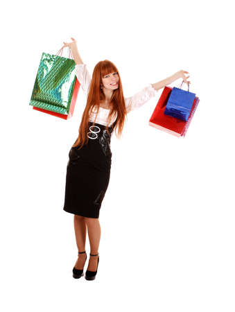 boxing day sale: Beautiful young woman with color shopping bags in her hand. Isolated on white background
