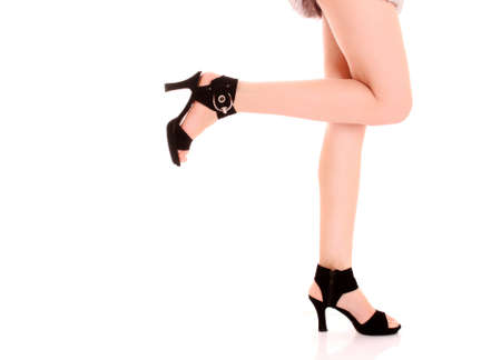 long woman legs in high heels isolated on white Stock Photo - 7234378