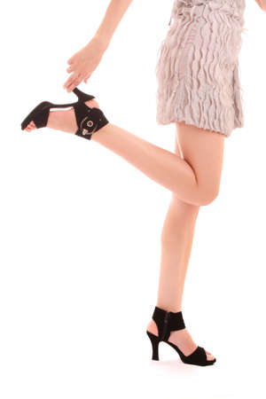 long woman legs in high heels isolated on white Stock Photo - 7234427