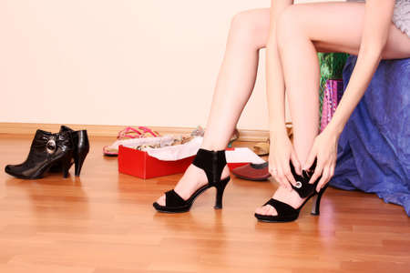 Young woman trying on new shoes in a store. photo