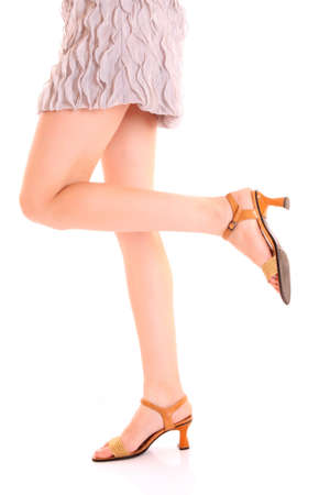 long woman legs in high heels isolated on white photo