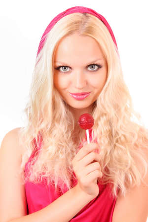Beautiful blond girl in pink dress with candy  on white photo