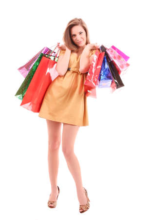boxing day sale: Beautiful young woman with color shopping bags in her hand. Isolated on white background.