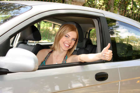 young woman with keys to new car photo