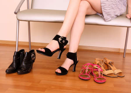 Young woman trying on new shoes in a store photo