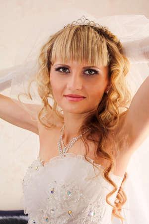 Beautiful Blond bride  on her wedding day photo