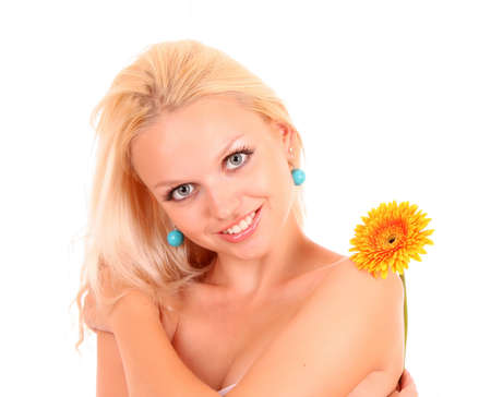 Beautiful young woman with yellow flower. Isolated on white background photo