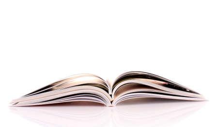 Pile of open magazines isolated on white background photo