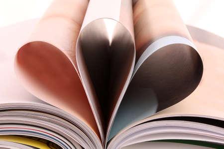 Pile of open magazines isolated on white background Stock Photo - 7798953