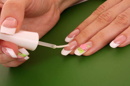 Beautiful woman hands with french manicure on pink background Stock Photo - 7798954