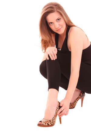 sexual selection: Fashion portrait of a beautiful young woman in leopard shoes
