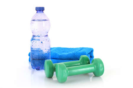 dumbell: Blue bottle of water, sports towel and exercise equipment isolated against a white background Stock Photo
