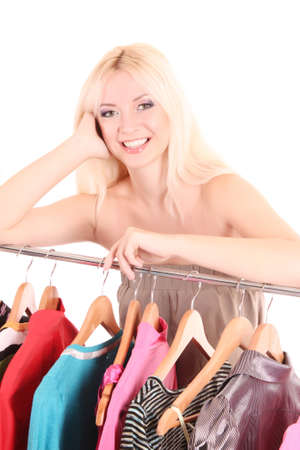 Beautiful young blonde woman select dress photo