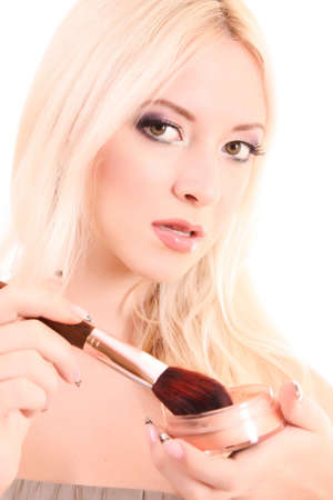 Portrait of attractive young blonde woman applying blusher Stock Photo - 7890500