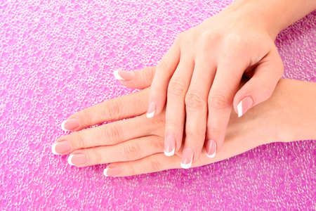 Beautiful woman hands with french manicure on pink background Stock Photo - 8081549