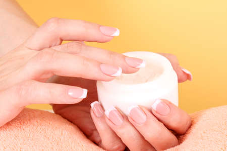 Woman applying cream on her hand Stock Photo - 8140787