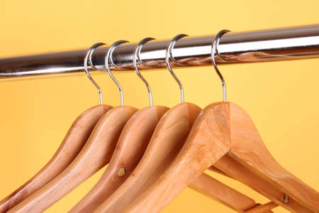 wooden coat hangers on a clothes rail photo